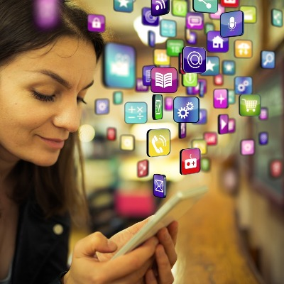 woman selecting apps on her mobile device