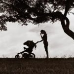 woman pushing baby carriage illustration