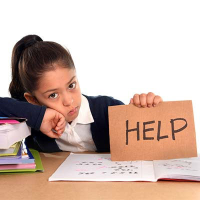 "school child with ""help"" sign"