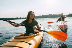 woman kayaking with partner