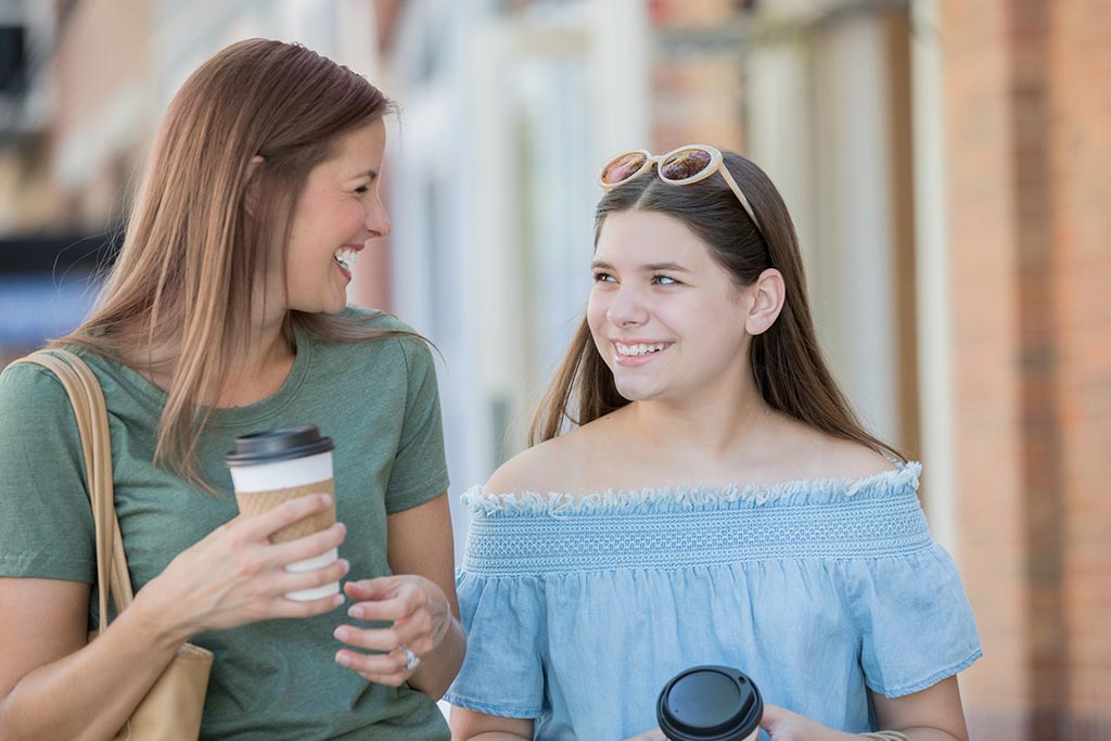 Mother and daughter enjoying coffee